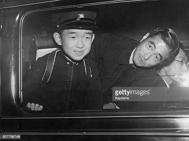 Prince Yoshi the youngest son of Emperor Hirohito leaves the Gakushuin or Peers School Japan accompanied by an attendant 8th November 1945