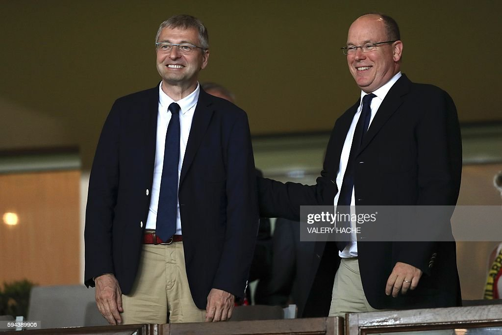Prince's Albert II of Monaco (R) and Monaco's Russian President Dmitriy Rybolovlev react during the UEFA Champions League second leg play off football match between AS Monaco and Villarreal CF on August 23, 2016 at the Louis II Stadium in Monaco. / AFP / VALERY