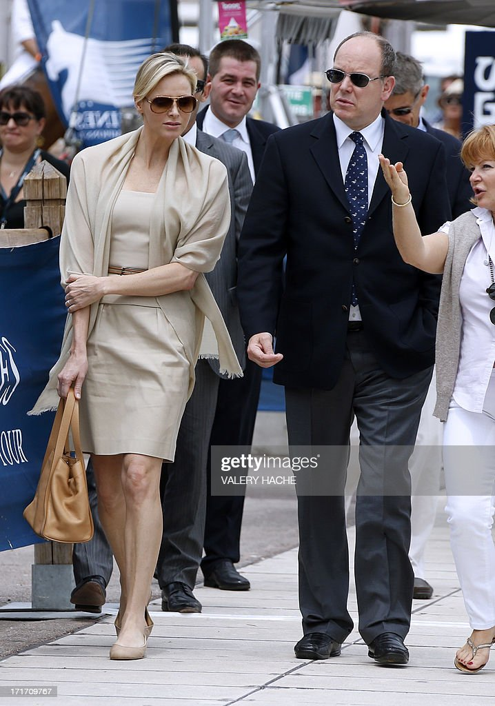 Prince's Albert II of Monaco and Princess Charlene arrive at the 2013 Monaco International Jumping as part of Global Champions Tour on June 28, 2013 in Monaco.