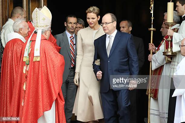 Prince's Albert II of Monaco and Princess Charlene of Monaco leave the Monaco Cathedral during the SainteDevote festivities on January 27 2017 in...
