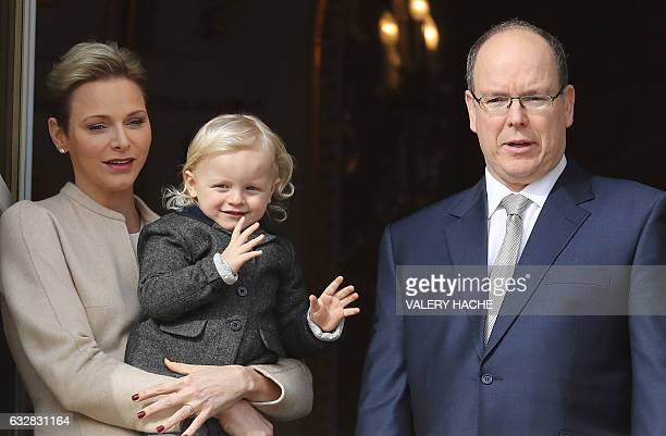 Prince's Albert II of Monaco and Princess Charlene of Monaco pose with their child Prince's Jacques at the balcony during the SainteDevote...