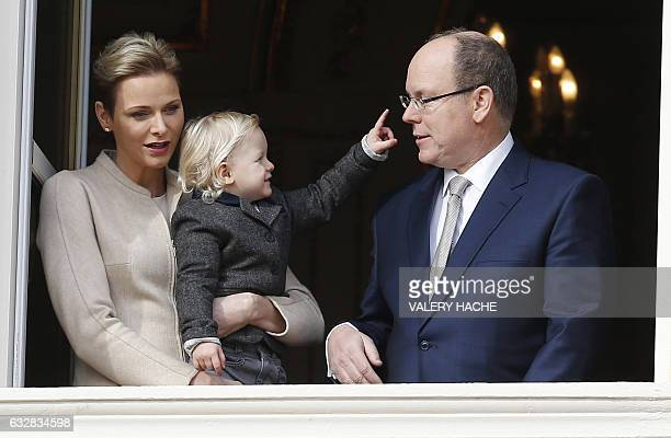 TOPSHOT Prince's Albert II of Monaco and Princess Charlene of Monaco pose with their child Prince's Jacques at the balcony during the SainteDevote...