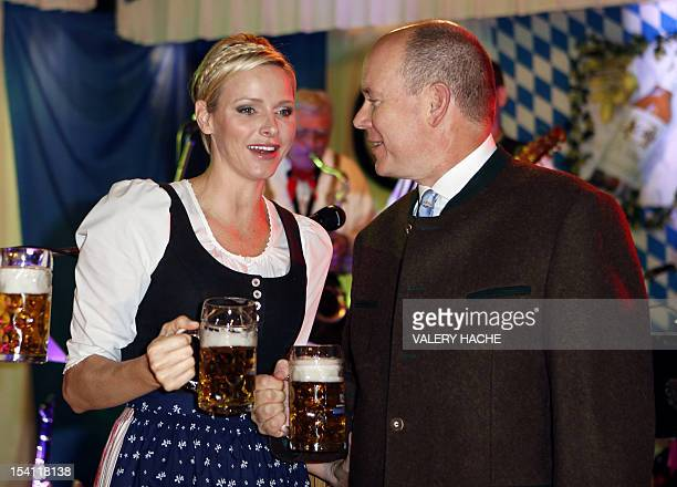 Prince's Albert II of Monaco and Princess Charlene of Monaco toast with beer mugs during the opening of the 7th edition of the 'Oktoberfest' on...