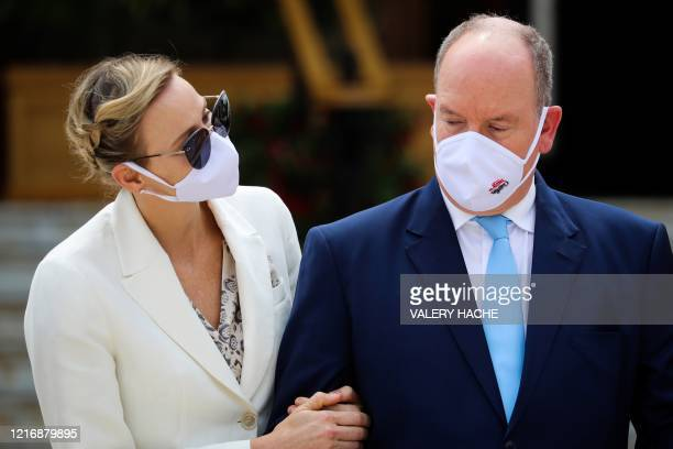 Prince's Albert II of Monaco and Princess Charlene of Monaco wearing a protective facemask, attend the inauguration of the new Casino place, in...