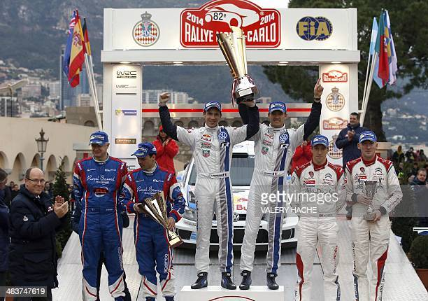 Prince's Albert II of Monaco applauds as French co driver Xavier Panseri French driver Bryan Bouffier French driver Sebastien Ogier French co driver...