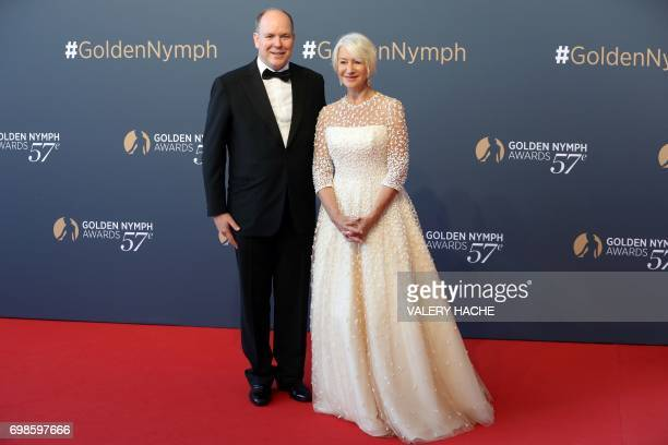Prince's Albert II of Monaco poses with British actress Helen Mirren during the closing ceremony of the 57th MonteCarlo Television Festival on June...