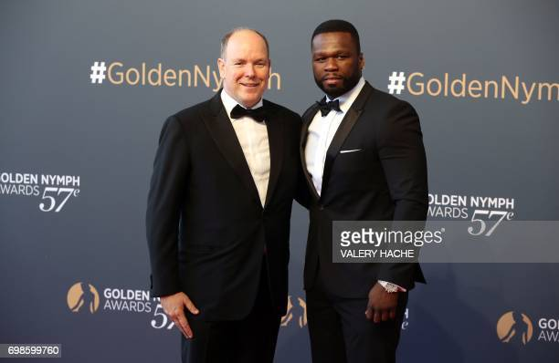 Prince's Albert II of Monaco poses with US actor and rappeur 50 Cent aka Curtis Jackson during the closing ceremony of the 57th MonteCarlo Television...