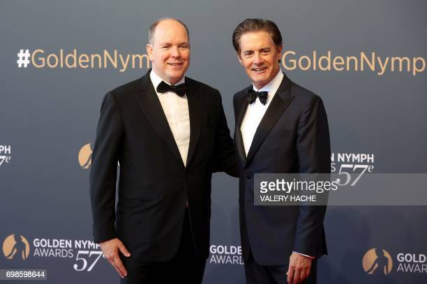 Prince's Albert II of Monaco poses with US actor Kyle MacLachlan during the closing ceremony of the 57th MonteCarlo Television Festival on June 20...