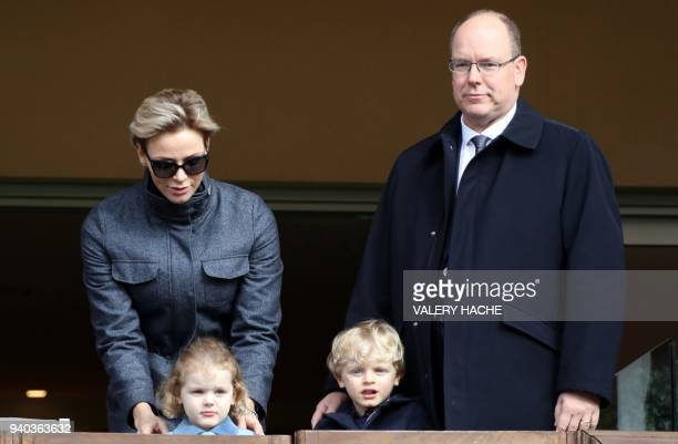 TOPSHOT Prince's Albert II of Monaco Princess Charlene of Monaco Prince's Jacques of Monaco and princess Gabriella attend the Sainte Devote...
