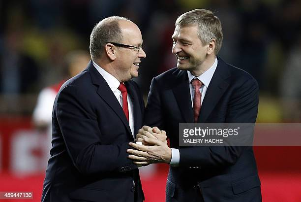 Prince's Albert II of Monaco shakes hands with AS Monaco's Russian president Dmitry Rybolovlev prior to the French L1 football match Monaco vs Caen...