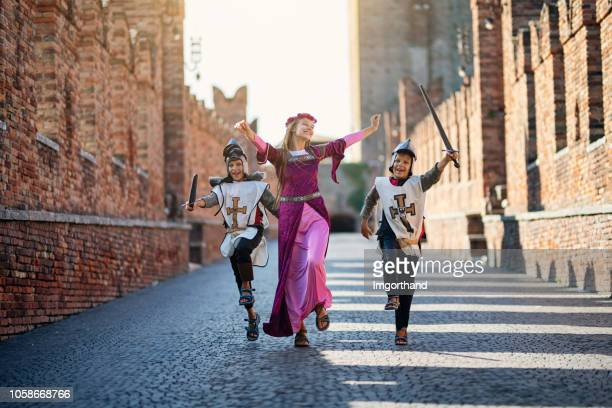 princes and her knights running through castle courtyard - fairytale stock pictures, royalty-free photos & images
