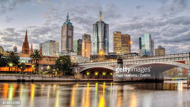 Princes Bridge With Reflection On Yarra River In City Against Sky