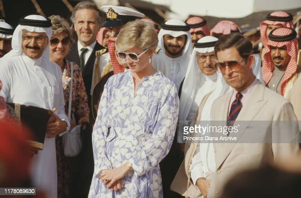 Princes Charles and Diana, Princess of Wales attend a picnic in the desert near Riyadh, Saudi Arabia, November 1986. She is wearing a blue and white...