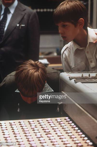 Princes Paul and Nicholas of Greece visit a sweet factory in 1970