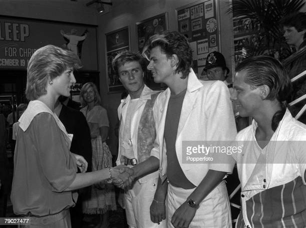 Princes Trust Rock Gala London England 20th July Diana the Princess of Wales shakes hands with John Taylor of the pop group Duran Duran ans lead...