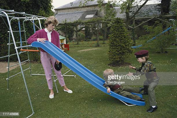 Princes William and Harry wearing the uniform of the Parachute Regiment of the British Army in the garden of Highgrove House in Gloucestershire, 18th...