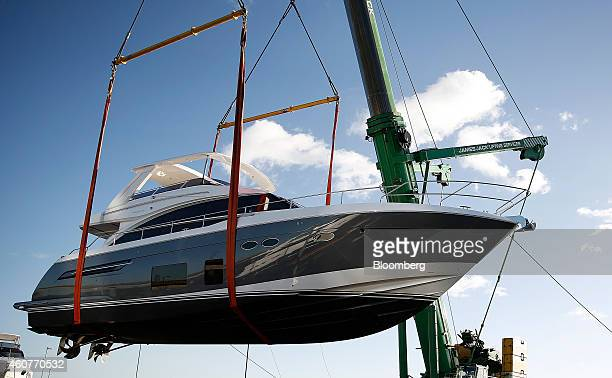 A Princess 88 Luxury Yacht Manufactured By Yachts International Plc Is Lifted From The Water