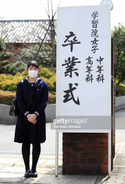 Princess Aiko, daughter of Emperor Naruhito, wearing a face mask amid the coronavirus outbreak, poses for photographs prior to the graduation...