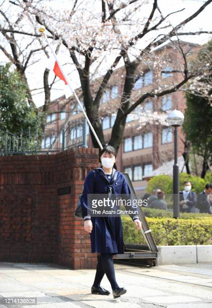 Princess Aiko, daughter of Emperor Naruhito, wearing a face mask amid the coronavirus outbreak, arrives at Gakushuin Girls' Senior High School prior...