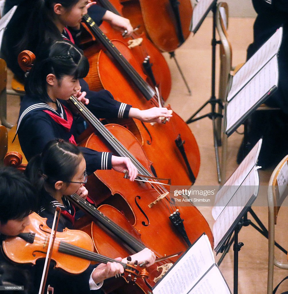 Princess Aiko (C) plays the cello during the All Gakushuin University Orchestra Concert at Gakushuin University on April 14, 2013 in Tokyo, Japan.