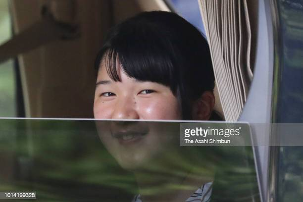 Princess Aiko smiles to media reporters on arrival at the Togu Palace after studying abroad on August 9 2018 in Tokyo Japan