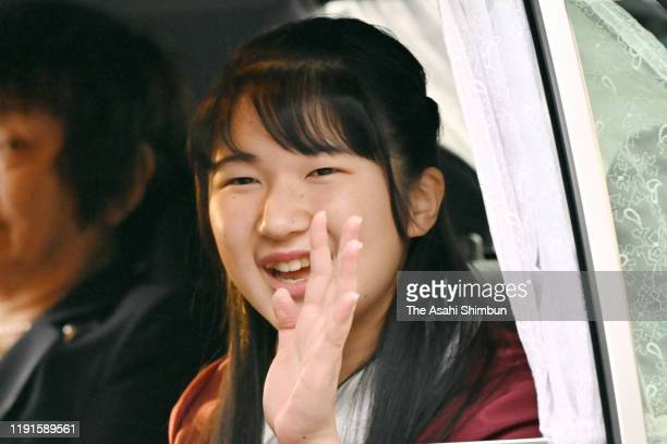 Princess Aiko waves to media reporters on arrival at the Imperial Palace on her 18th birthday on December 1, 2019 in Tokyo, Japan.