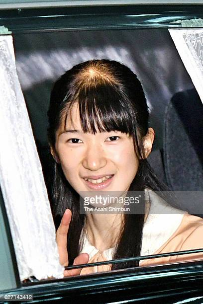 Princess Aiko waves to media reporters on arrival at the Imperial Palace to greet Emperor Akihito and Empress Michiko on her 15th birthday on...