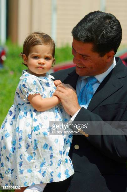 Princess Aleksia of Greece's husband Carlos Morales holds their first daughter Arrieta during an official presentation to the press of their second...