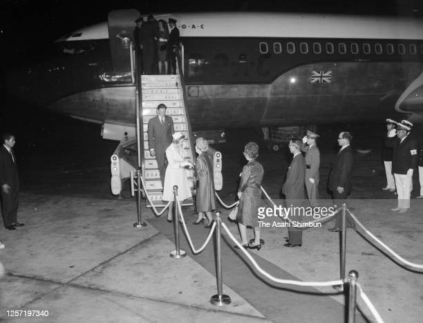 Princess Alexandra and her husband Angus Ogilvy are welcomed by Princess Setsuko of Chichibu on arrival at Haneda Airport on September 20, 1965 in...