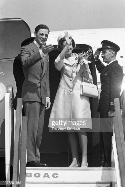 Princess Alexandra and her husband Angus Ogilvy wave on departure at Haneda Airport on September 30, 1965 in Tokyo, Japan.