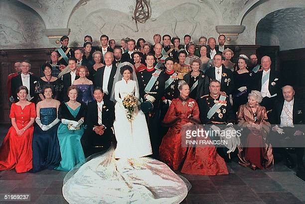 Princess Alexandra and Prince Joachim of Denmark are flanked by members of their families during the photo call for the family photo following their...