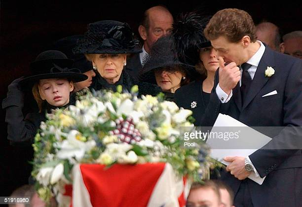 Princess Alexandra follows the coffin of her husband Sir Angus Ogilvy with their daughter Marina and son James after his funeral held in St Georges...