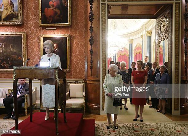 Princess Alexandra gives a speech as Queen Elizabeth II Sophie Countess of Wessex look on during a reception to celebrate the patronages of the...