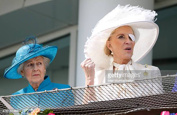 Princess Alexandra looks on as Princess Michael of Kent cheers whilst watching the racing from the balcony of the Royal Box on Derby Day during the...