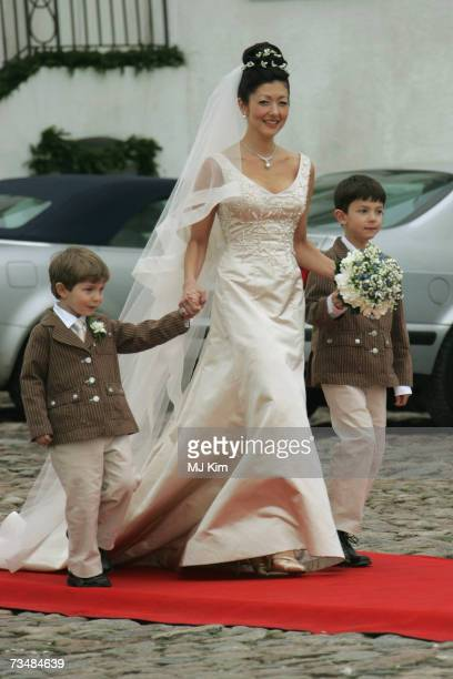 Princess Alexandra of Denmark and her children Prince Felix and Prince Nicolai arrive for her wedding ceremony to photographer Martin Jorgensen at...