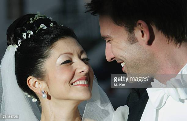 Princess Alexandra of Denmark and her husband Martin Jorgensen pose for photographers after their wedding ceremony at Oster Egende Church on March 03...