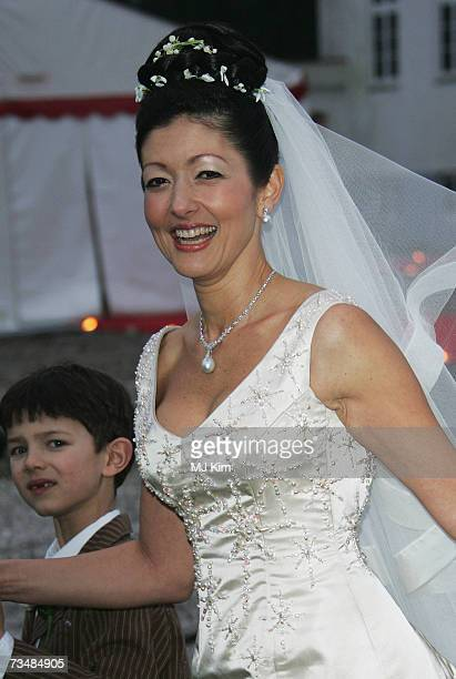 Princess Alexandra of Denmark and her son Prince Nicolai pose for photographers after her wedding ceremony to photographer Martin Jorgensen at Oster...