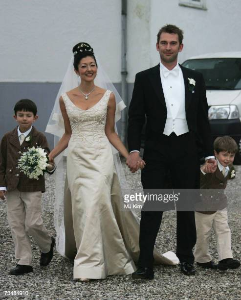 Princess Alexandra of Denmark her husband Martin Jorgensen and her children Prince Nicolai and Prince Felix pose after the wedding ceremony at Oster...