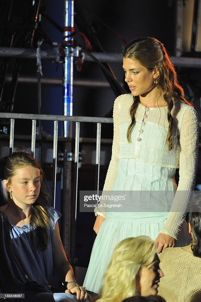 Princess Alexandra of Hanover talks to Charlotte Casiraghi during the Jean Michel Jarre concert at the Port of Monaco after the civil ceremony of the Royal Wedding of Prince Albert II of Monaco to Charlene Wittstock at the Prince's Palace on July 1, 2011 in Monaco.