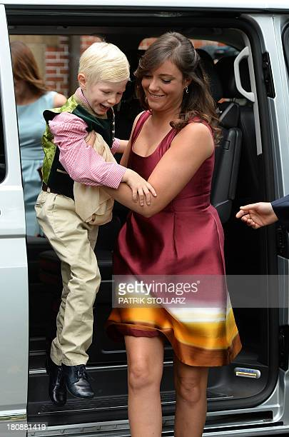Princess Alexandra of Luxembourg holding Prince Noah of Luxembourg arrives at the Civil Wedding Ceremony of her brother on September 17, 2013 in...