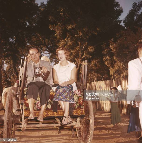 Princess Alexandra pictured seated with Burmese politician General Ne Win in the rear of a bullock cart on a tour of the ancient city of Bagan in the...