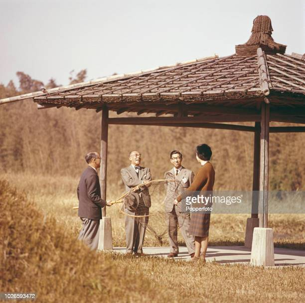 Princess Alexandra pictured with three male members of the Japanese Imperial Family in the grounds of a royal residence during a duck netting trip...