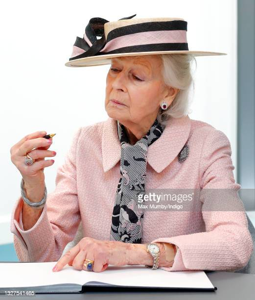 Princess Alexandra signs the visitor's book as she visits the Guide Dogs for the Blind Association to open their new south west regional centre and...