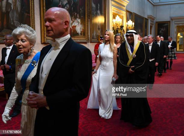 Princess Alexandra, The Honourable Lady Ogilvy, William Hague, followed by Suzanne Ircha and the Ambassador of Kuwait arrive through the East Gallery...
