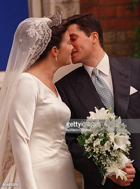 Princess Alexia daughter of the exiled King Constantine of Greece kisses her new husband Carlos Morales Quintana of Spain after their wedding at the...