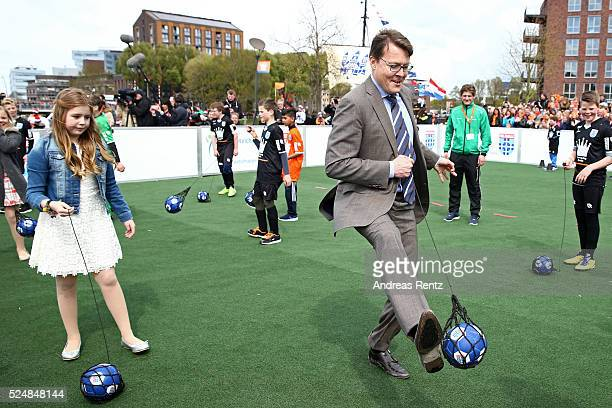 Princess Alexia of The Netherlands and Prince Constantijn of The Netherlands play football during King's Day the celebration of the birthday of the...