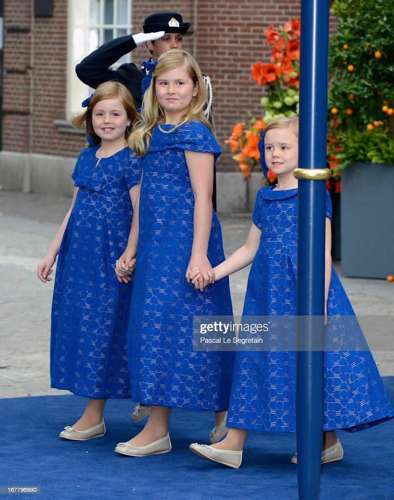 Princess Alexia (L), Princess Catharina Amalia and Princess Ariane (R) of the Netherlands depart the Nieuwe Kerk to return to the Royal Palace after the abdication of Queen Beatrix of the Netherlands and the Inauguration of King Willem Alexander of the Netherlands on April 30, 2013 in Amsterdam, Netherlands.