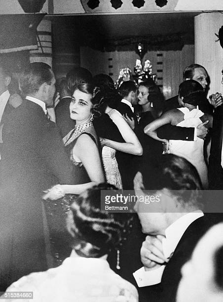Princess Alexis Mdivani the former Barbara Hutton heiress to the Woolworth Millions dancing with one of her guests at a party celebrating her...