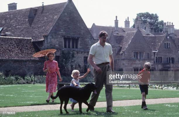 Princess Alice Duchess of Gloucester with the Duke of Gloucester and Lady Davina Windsor and Alexander the Earl of Ulster in the garden of Barnwell...