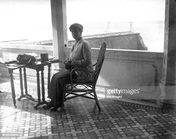Princess Alice of Greece is seen knitting woollen caps for Greek troops, whilst on the verandah of a villa overlooking the Bay of Salonika, which was...